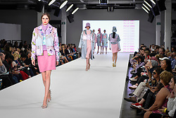 © Licensed to London News Pictures. 04/06/2018. London, UK.  A model presents a look by Pui Si Tang from Birmingham University on day two of Graduate Fashion Week taking place at the Old Truman Brewery in East London. The event presents the graduation show of up and coming fashion designers from UK and international universities.  Photo credit: Stephen Chung/LNP