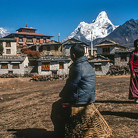 Young Tibetan Buddhist monks relax outside  at Tengboche Monastery in the Khumbu region of Nepal. in 1986., before the old monastery  was destroyed and by an electrical fire in 1989 and subsequently rebuilt.