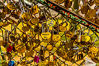 Symbols of undying love, padlocks  are attached to a fence outside Sacre Coeur Basilica on Montmartre, Paris, France.