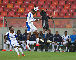 James Okwuosa of Chippa United poaches a header from Luvuyo Memela of Orlando Pirates during the 2016 Premier Soccer League match between Chippa United and Orlando Pirates held at the Nelson Mandela Bay Stadium in Port Elizabeth, South Africa on the 22th November  2016.<br /> <br /> Photo by:   Richard Huggard / Real Time Images