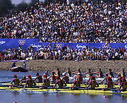 Sydney, AUSTRALIA, ROM W8+ leading the field as their approach the finishing line in the Olympic final for Women's eights, at the 2000 Olympic Regatta, Penrith Lakes. [Photo Peter Spurrier/Intersport Images]  right to left] bow, DAMIAN, Georgeta, SUSANU Viorica, OLTEANU Ioana, COCHELEA Veronica, DUMITRACHE Maria Magdalena, LIPA Elisabeta, GAFENCU Liliana, stroke,.IGNAT Doina and cox GEORGESCU Elena. Rowing Course: Penrith Lakes, NSW 2000 Olympic Regatta Sydney International Regatta Centre (SIRC) 2000 Olympic Rowing Regatta00085138.tif