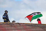 """Tamworth, United Kingdom, May 25, 2021: Police appear to be arrested one of three of the """"Palestine Action"""" activists who scaled on the rooftop of an Israeli owned arms manufacturer Elbit on the early morning of Tuesday, May 25, 2021. Activists painted red colour on Building's roof as well as its logo """"Elite KL"""".  (Photo by Vudi Xhymshiti)"""