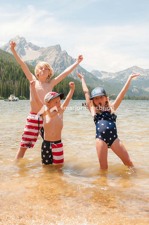 Kids in red, white, and blue enjoy Stanley Lake during fourth of July weekend. Stanley, Idaho. MR