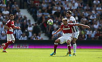 Middlesbrough's Gaston Ramirez shields the ball from West Bromwich Albion's Claudio Yacob<br /> <br /> Photographer Stephen White/CameraSport<br /> <br /> The Premier League - West Bromwich Albion v Middlesbrough - Sunday 28 August 2016 - The Hawthorns - West Bromwich<br /> <br /> World Copyright © 2016 CameraSport. All rights reserved. 43 Linden Ave. Countesthorpe. Leicester. England. LE8 5PG - Tel: +44 (0) 116 277 4147 - admin@camerasport.com - www.camerasport.com