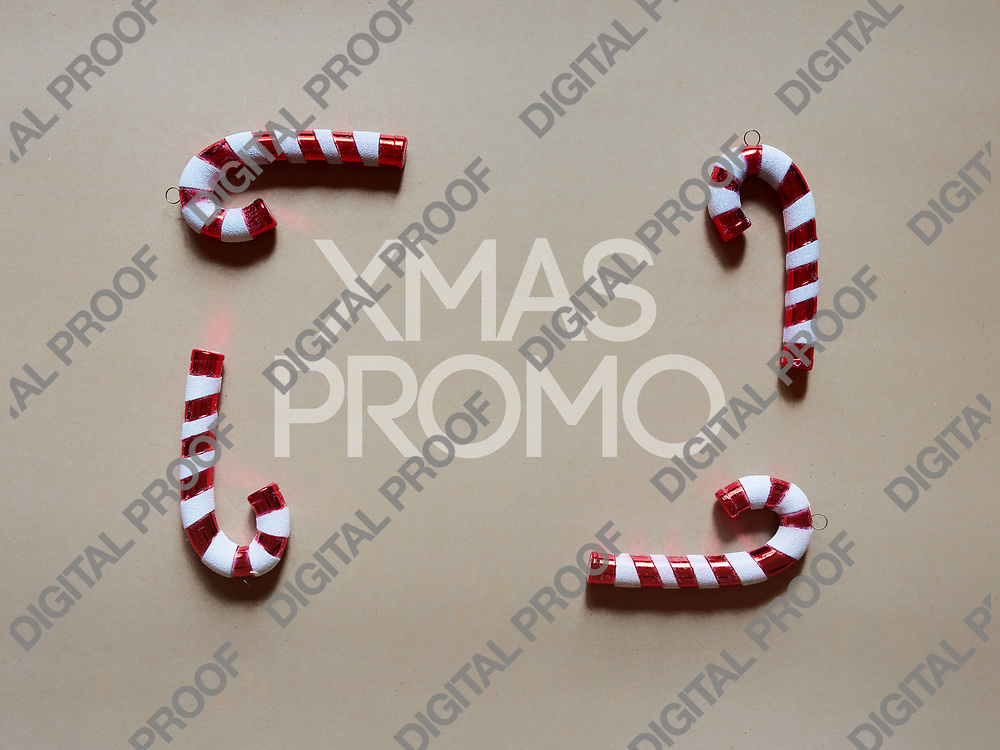 Christmas candy cane drums  at studio above view over a brwon cream neutral background isolated flatlay
