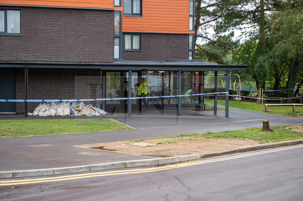 © Licensed to London News Pictures. 25/09/2019. Headington, UK. Police at the entrance to Foresters Tower. Thames Valley Police were called to Foresters Tower in Wood Farm Road, Headington, at 21:18 BST on 24th September 2019 to reports that a man had fallen from an upper floor of Foresters Tower. The man died at the scene. <br /> Following a search of flats at Foresters Tower, a woman was located on the fourth floor with severe neck injuries and was pronounced dead at the scene.. Photo credit: Peter Manning/LNP