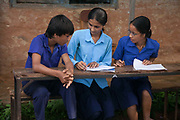 Students competing in a quiz. Above Dhading, Pasupati School. Grade 9 and 10 have extra lessons in their summer break from 6am-10am to prepare them for their finals.