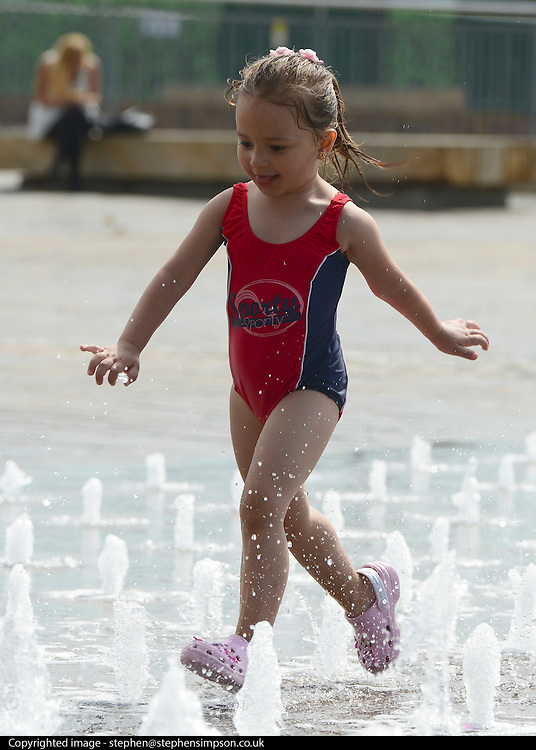 © Licensed to London News Pictures. 19/08/2012. London, UK (Name not supplied)Children play in the fountains at Granary Square in North London today. 1080 dancing jets of water make up the new fountain in its centre. Today is expected to be the hottest day of the year with temperature peaking at over 32 degrees celsius. Photo credit : Stephen Simpson/LNP