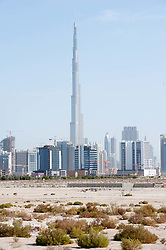 Skyline of Dubai and desert with Burj Khalifa tower the world's highest building United Arab Emirates UAE