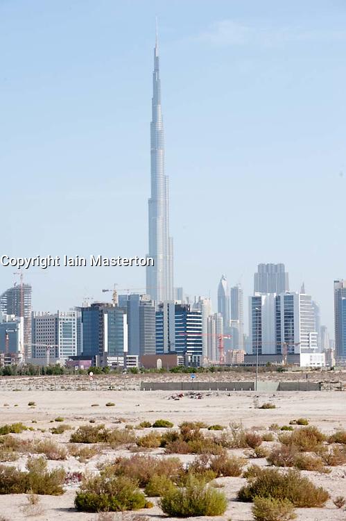 Skyline of Dubai and desert with Burj Khalifa tower the world's highest building United Arab Emirates UAE