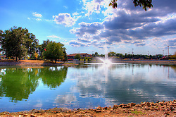 05 September 2013:   Lake, grounds and beach house at G. J. Mercherle (State Farm) Park in Bloomington Illinois<br /> <br /> This image was produced in part utilizing High Dynamic Range (HDR) processes.  It should not be used editorially without being listed as an illustration or with a disclaimer.  It may or may not be an accurate representation of the scene as originally photographed and the finished image is the creation of the photographer.