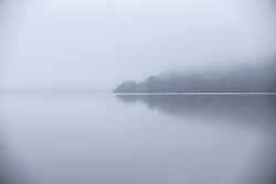 September 14, 2016 - Glenridding, Cumbria, UK - Glenridding UK. Picture shows Ullswater Lake in the morning mist at Glenridding this morning. After last nights thunderstorms in the north of England Cumbria woke to a calm but misty morning. (Credit Image: © Andrew Mccaren/London News Pictures via ZUMA Wire)