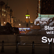 Nelson's column in Trafalgar Square in London is lit up with art work by Banksy as part of a vigil to to launch the Stand with Syria campaign. The campaign aims to highlight the fact that the war in Syria has been going on for three years on March 15 and that the war must stop.