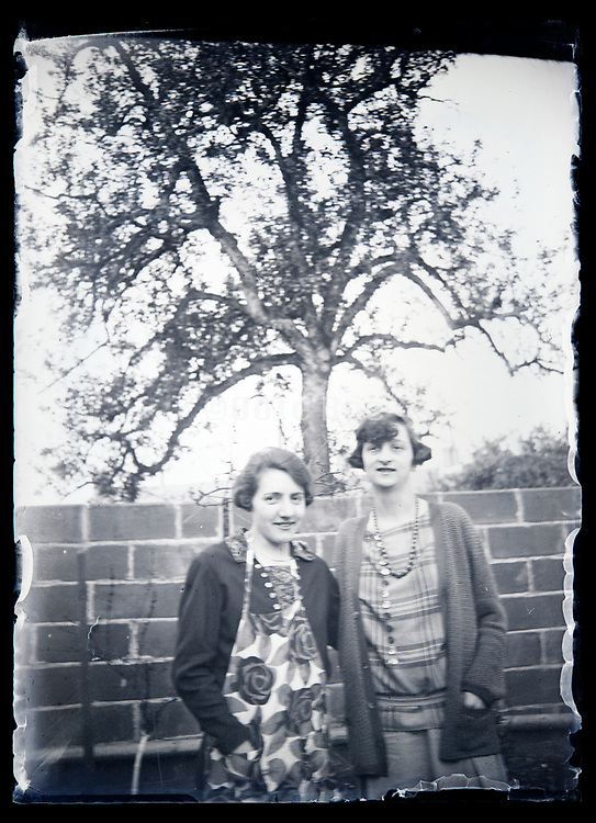 female friends standing in backyard garden France circa 1930s