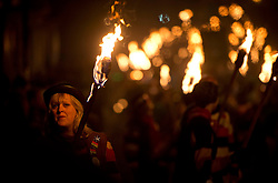"""© London News Pictures. 05/11/2013 . Lewes, UK.  Bonfire societies parade through the streets of Lewes, East Sussex, during as part of traditional bonfire night celebrations. Thousands of people line the narrow streets as bonfire societies parade in costume with the evening ending in the burning of the """"guy"""". Bonfire Night marks the date of the uncovering of the Gunpowder Plot in 1605 and commemorates the memory of the seventeen Protestant martyrs. Photo credit : Ben Cawthra/LNP"""