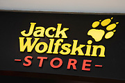Sign for the outdoor clothing brand Jack Wolfskin in Birmingham, United Kingdom.