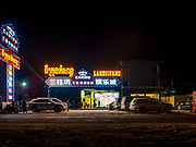 """13 FEBRUARY 2019 - SIHANOUKVILLE, CAMBODIA:  The Languifang, a small Chinese owned casino, several miles in a semi rural area several miles from Sihanoukville. There are about 80 Chinese casinos and resort hotels open in Sihanoukville and dozens more under construction. The casinos are changing the city, once a sleepy port on Southeast Asia's """"backpacker trail"""" into a booming city. The change is coming with a cost though. Many Cambodian residents of Sihanoukville  have lost their homes to make way for the casinos and the jobs are going to Chinese workers, brought in to build casinos and work in the casinos.      PHOTO BY JACK KURTZ"""