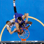 Anadolu Efes's Stephane Lasme (R) and Dario Saric (C) during their Turkish Airlines Euroleague Basketball Top 16 Round 11 match Anadolu Efes between Nizhny Novgorod at Abdi ipekci arena in Istanbul, Turkey, Thursday March 19, 2015. Photo by Aykut AKICI/TURKPIX