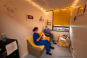 The Well-being Room at Ysbyty Gwynedd was a space created by nurses themselves in which they could take a few moments out to keep their minds together during the intense & very long shifts trying to keep patients alive, and cared for. <br /> <br /> From my exhibition series for  Betsi Cadwaladr via the Betsi Research Unit.<br /> <br /> My brief was not frontline action as seen on all news outlets, but the way hospitals & staff have adapted to cope with the crisis, from PPE to social distancing & also those vital behind the frontline workers essential throughout the crisis to support frontline NHS staff.<br />  <br /> A small touring exhibition will be open to the public when safer times permit.