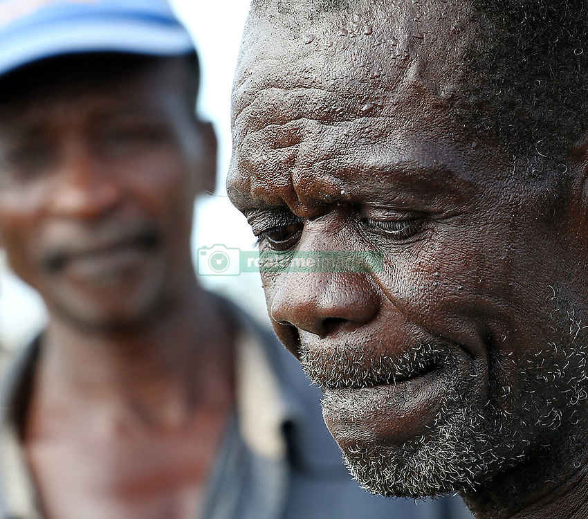 Jean Lamar and Marcorel Nicola build a tent for shelter outside of Jeremie, Haiti on Monday, Oct. 10, 2016. Lamar lost an 18 year old son during Hurricane Matthew and Nicola also lost 2 children during the storm. Photo by Patrick Farrell/Miami Herald/TNS/ABACAPRESS.COM
