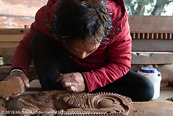 Religious (and erotic) sculptures damaged during the 2015 earthquake were being restored during our visit to the Nuwakot Durbar, an 18th century royal palace, before our rideout on day-10 of our Himalayan Heroes adventure  riding from Nuwakot back to Kathmandu, Nepal. Thursday, November 15, 2018. Photography ©2018 Michael Lichter.
