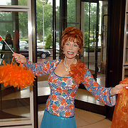 NLD/Amsterdam/20060614 - Haringparty 006 Hilton hotel Amsterdam, Marijke Helwegen ivm voetbal met oranje tas, vlag en sjaal