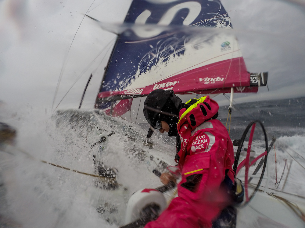 AT SEA - NOVEMBER 2: Onboard Team SCA. Stacey Jackson prepares to take a wave during her watchduring Leg 1 between Alicante, Spain and Cape Town, South Africa. The Volvo Ocean Race 2014-15 is the 12th running of this ocean marathon. Starting from Alicante in Spain on October 11, 2014, the route, spanning some 39,379 nautical miles, visits 11 ports in 11 countries (Spain, South Africa, United Arab Emirates, China, New Zealand, Brazil, United States, Portugal, France, the Netherlands and Sweden) over nine months. The Volvo Ocean Race is the world's premier ocean race for professional racing crews. (Photo by Corinna Halloran/Team SCA/Volvo Ocean Race via Getty Images)
