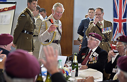 File photo dated 05/06/14 of the Prince of Wales (centre) raising his glass to D-Day veterans during lunch at a community centre in Ranville, Normandy, France, as part of the 70th anniversary of the D-Day campaign.