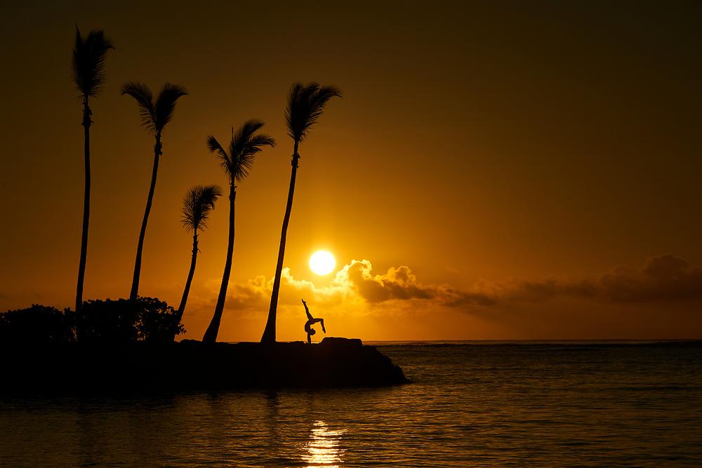 Honolulu, HI - January 12: A female yogi practices at sunrise. Photographed in Honolulu, HI on January 12, 2018. (Photograph ©2018 Darren Carroll)