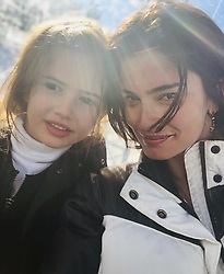 """Shermine Shahrivar releases a photo on Instagram with the following caption: """"Good morning from the #sharivari \u2018s \ud83e\udd70 #loveofmylife #youandme #collectingmemories #hotchocolate \ud83c\udde8\ud83c\udded\ud83c\udf6b\ud83d\udc69\ud83c\udffb\ud83e\uddd2\ud83c\udffc"""". Photo Credit: Instagram *** No USA Distribution *** For Editorial Use Only *** Not to be Published in Books or Photo Books ***  Please note: Fees charged by the agency are for the agency's services only, and do not, nor are they intended to, convey to the user any ownership of Copyright or License in the material. The agency does not claim any ownership including but not limited to Copyright or License in the attached material. By publishing this material you expressly agree to indemnify and to hold the agency and its directors, shareholders and employees harmless from any loss, claims, damages, demands, expenses (including legal fees), or any causes of action or allegation against the agency arising out of or connected in any way with publication of the material."""