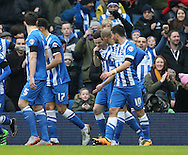 Brighton winger, Jamie Murphy (15) scores the opening goal and celebrates during the Sky Bet Championship match between Brighton and Hove Albion and Bolton Wanderers at the American Express Community Stadium, Brighton and Hove, England on 13 February 2016.