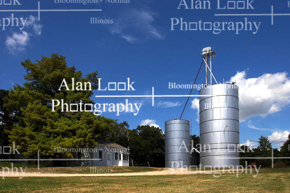 27 August 2011: High Dynamic Range image (HDR) of A grain processing plant from the 1940's or 50's still sits at Funks Grove along historic Route 66 in McLean County Illinois.  The scale building and office are accompanied by 2 silver metal silos.