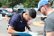 AFC Wimbledon midfielder Neset Bellikli (27) arriving during the Pre-Season Friendly match between AFC Wimbledon and Queens Park Rangers at the Cherry Red Records Stadium, Kingston, England on 14 July 2018. Picture by Matthew Redman.