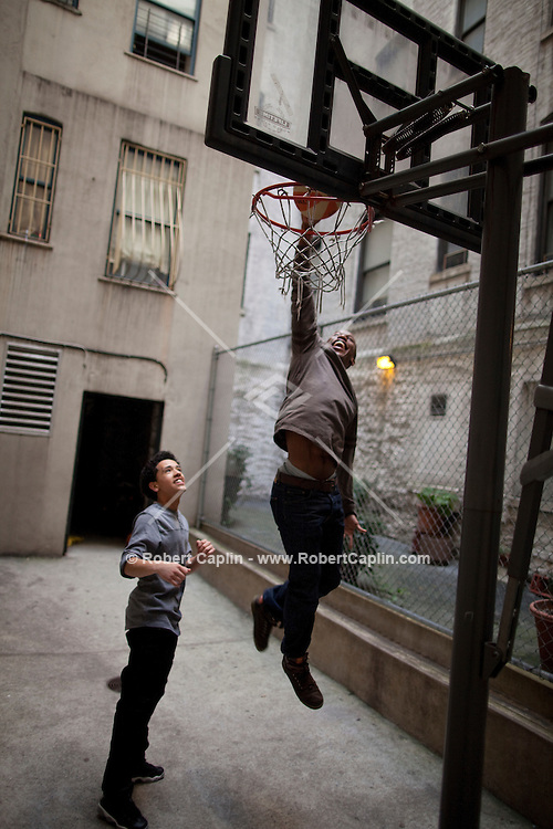 Mentor Jeremie Knight plays basketball with Christian Fernandez, 16 at Friends of the Children New York in Harlem...Photo by Robert Caplin.