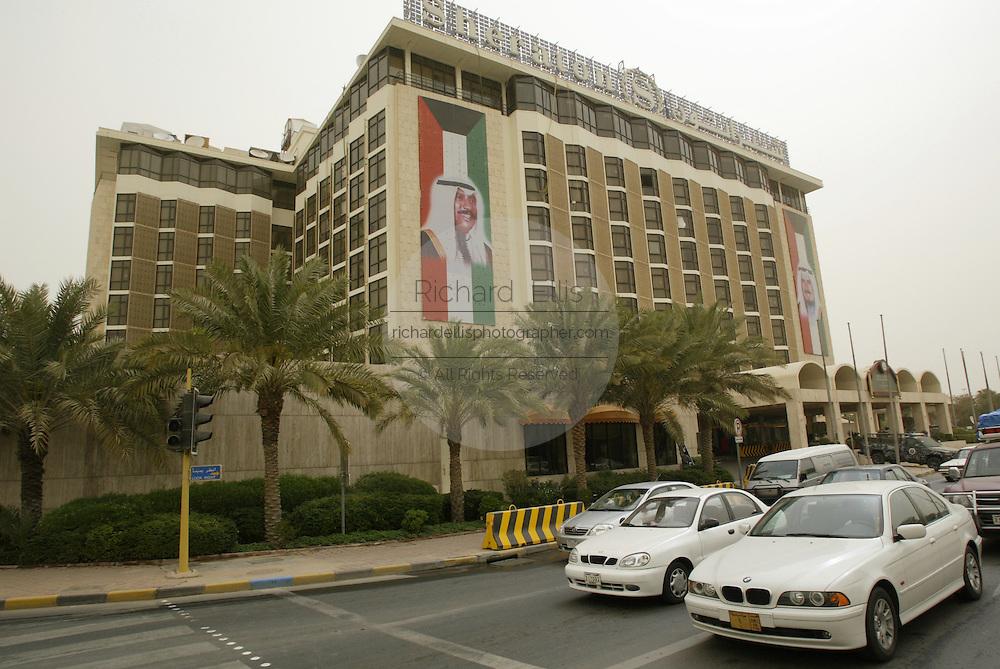 Sheraton Hotel in Kuwait City with banners of the Emir of Kuwait Sheikh Jaber Al-Ahmad Al-Jaber Al-Sabah (R) and the Crown Prince Sheikh Saad Al-Abdullah Al-Salem Al-Sabah.