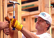 President Bill Clinton works to frame a house during a Habitat for Humanity house in Atlanta, Georgia. The build included volunteers such as Bill, Chelsea and Hilary Clinton, Al and Tipper Gore and Jimmy and Rosalynn Carter.