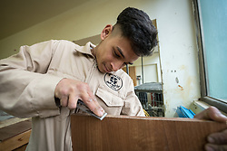 25 February 2020, Jerusalem: Emran Bukhari studies carpentry. The Lutheran World Federation's vocational training centre in Beit Hanina offers vocational training for Palestinian youth across a range of different professions, providing them with the tools needed to improve their chances of finding work.
