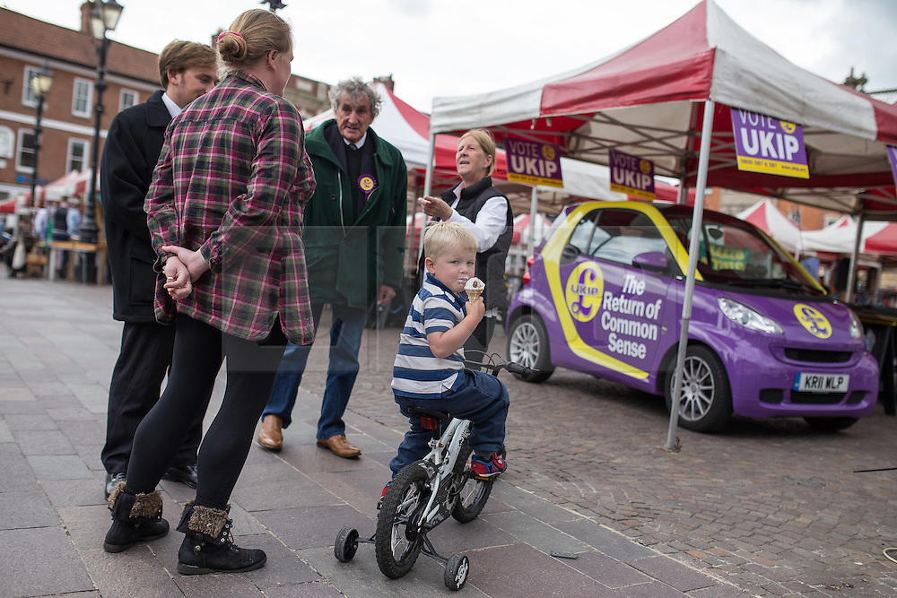 © Licensed to London News Pictures . 05/06/2014 . Newark , Nottinghamshire , UK . People gather around a UKIP Smart car in Market Square , Newark today (Thursday 5th June 2014) as voting takes place in the Newark by-election , following the resignation of incumbent Patrick Mercer . Photo credit : Joel Goodman/LNP