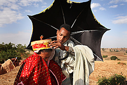 Priest Addisu Abebe, 23, and his new bride Destaye Amare, 11, are married in a traditional Ethiopian Orthodox wedding in the rural areas outside the city of Gondar, Ethiopia on Feb. 4, 2008. Since Abebe is a priest, it was necessary that he only marry a virgin.