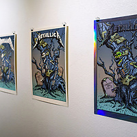 Artwork created for the band Metallica is exhibited with other Dan Grissom works in the Ingham Chapman Gallery at the University of New Mexico Gallup Campus Thursday.