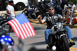March 8, 2019 - Daytona, FL, United States - A motorcyclist parades down Main Street on March 8, 2019 for the opening day of Bike Week in Daytona Beach, Florida. The 10-day event, which draws thousands of motorcycle riders and enthusiasts from around the world, is celebrating its 78th year. (Credit Image: © Paul Hennessy/NurPhoto via ZUMA Press)