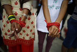 August 15, 2017 - Kathmandu, Nepal - Hands of activists are symbolically tied during a demonstration to save the life of Dr. Govinda KC who has been on a hunger strike for the last 23 days for the 11th time demanding reforms in medical education sector in Kathmandu, Nepal. (Credit Image: © Skanda Gautam via ZUMA Wire)