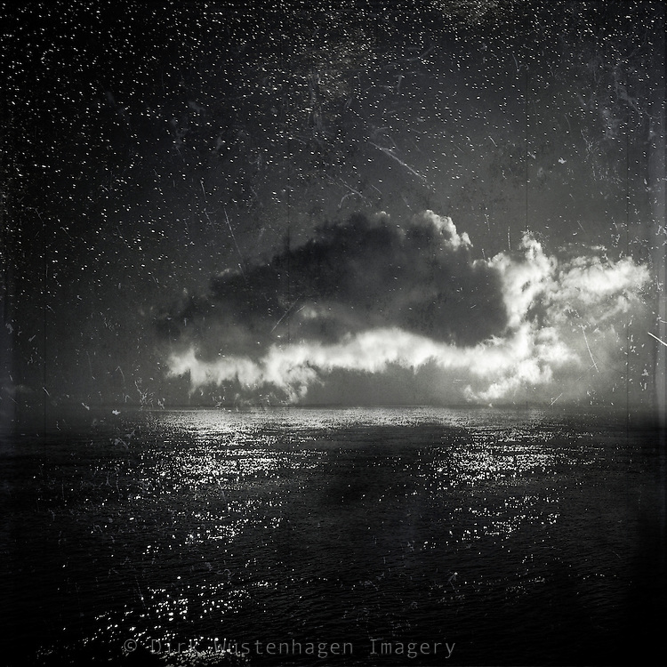 Composing of a cloud picture and a pic of the calm North Sea.<br /> <br /> Prints: http://society6.com/DirkWuestenhagenImagery/bright-cloud-black-sea_Print