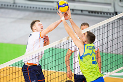 30-12-2019 SLO: Slovenia - Netherlands, Ljubljana<br /> Jan Kozamernik of Slovenia and Michaël Parkinson of the Netherlands during friendly volleyball match between National Men teams of Slovenia and Netherlands.