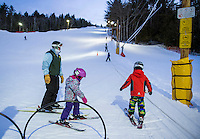 Ski Instructor Becky Bartlett loads her group on the rope tow for Thursday night lessons at the Abenaki Ski Area in Wolfeboro.  (Karen Bobotas/for the Laconia Daily Sun)