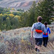 Two athletes run trails near the Teton Mountain Range near Jackson, Wyoming.