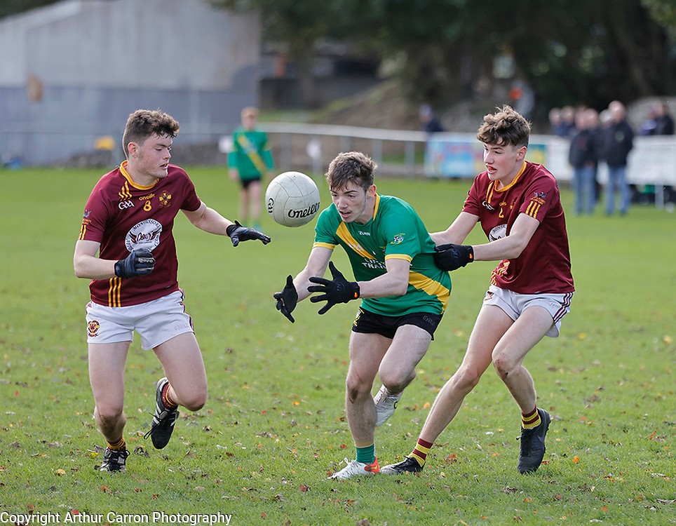 3/10/21 Thomas Davis player Stiofan O Dufaigh in action against St Oliver Plunkett's Enda Shaughnessy and Richie O'Driscoll  in their Dublin MFC B game in Kiltipper. Pictures: Arthur Carron