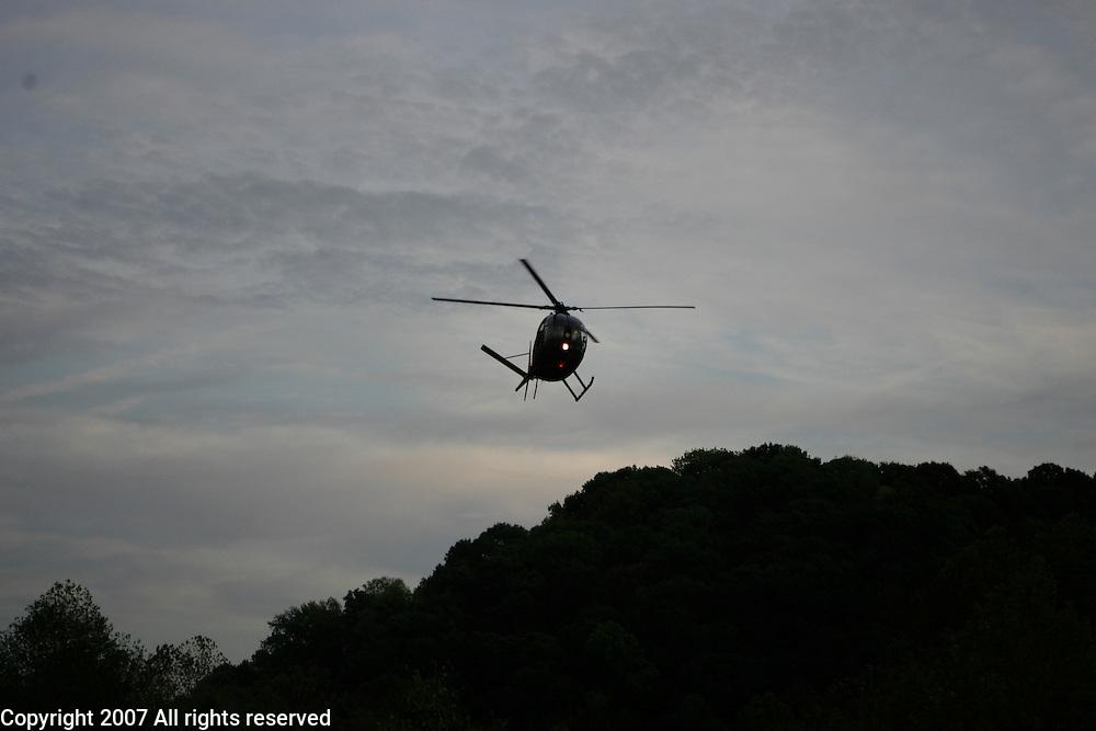 A Vietnam era OH-6 Cayuse, commonly called a Loach during the Vietnam War, flies during the Knob Creek machine gun shoot in Kentucky.