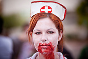 """Oct. 30, 2009 -- PHOENIX, AZ: ANNE STEGER, an Arizona State University student, walked as a Zombie nurse during the city's first """"Zombie Walk"""" Friday night. About 200 people participated in the first """"Zombie Walk"""" in Phoenix, AZ, Friday night. The Zombies walked through downtown Phoenix """"attacking"""" willing victims and mixing with folks going to the theatre and downtown sports venues.  Photo by Jack Kurtz"""