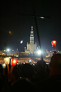 Faithful hold candles during a candlelight vigil at the Catholic Fatima shrine in central Portugal 12 October 2006. Thousands of pilgrims converged on Fatima to celebrate the anniversary of the first apparition of the Virgin Mary to three shepherd children on 13 May 1917.PHOTO PAULO CUNHA/4SEE